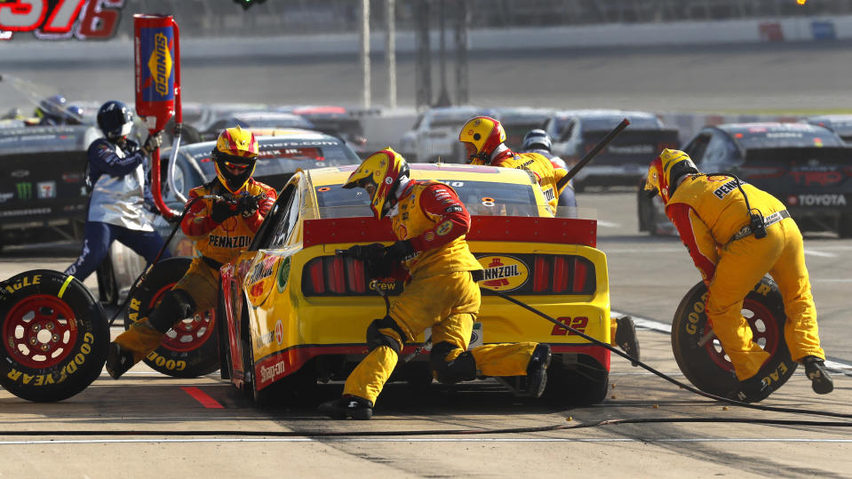 Joey Logano makes a pit stop during a NASCAR Cup Series auto race at Michigan International Speedway in Brooklyn, Mich., Sunday, Aug. 9, 2020. (AP Photo/Paul Sancya)