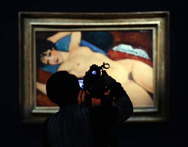 """Amedeo Modigliani's """"Nu Couche"""" or """"Reclining Nude"""", painted in 1917-18, sold after a frantic nine-minute bidding war between seven would-be buyers on the first time the painting has ever come to auction"""
