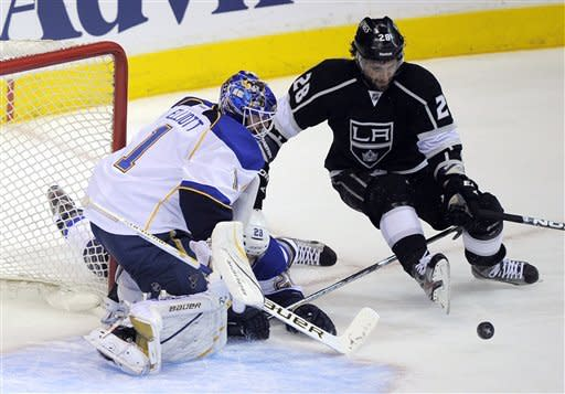 Los Angeles Kings center Jarret Stoll, right, tries to get a shot in on St. Louis Blues goalie Brian Elliott during the first period in Game 3 of an NHL hockey Stanley Cup second-round playoff series, Thursday, May 3, 2012, in Los Angeles. (AP Photo/Mark J. Terrill)