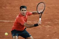 Switzerland's Roger Federer plays a return to Germany's Dominik Koepfer during their third round match on day 7, of the French Open tennis tournament at Roland Garros in Paris, France, Saturday, June 5, 2021. (AP Photo/Thibault Camus)