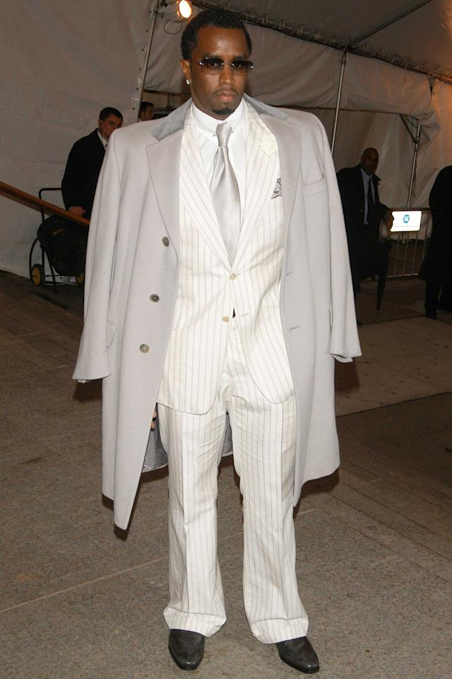 """<p><em>That year's exhibit: """"The House of Chanel""""</em></p><p>Sean Combs a.k.a. Diddy has never not had boss style on lock, but at 2005's Met Gala, the multi hyphenate rich guy went all in with a cream pinstripe suit, silver tie, on-shoulder topcoat, and healthy break at the bottom of his trousers that only rich guys who walk from the door of a chauffeured Phantom to their corner office can pull off.</p>"""