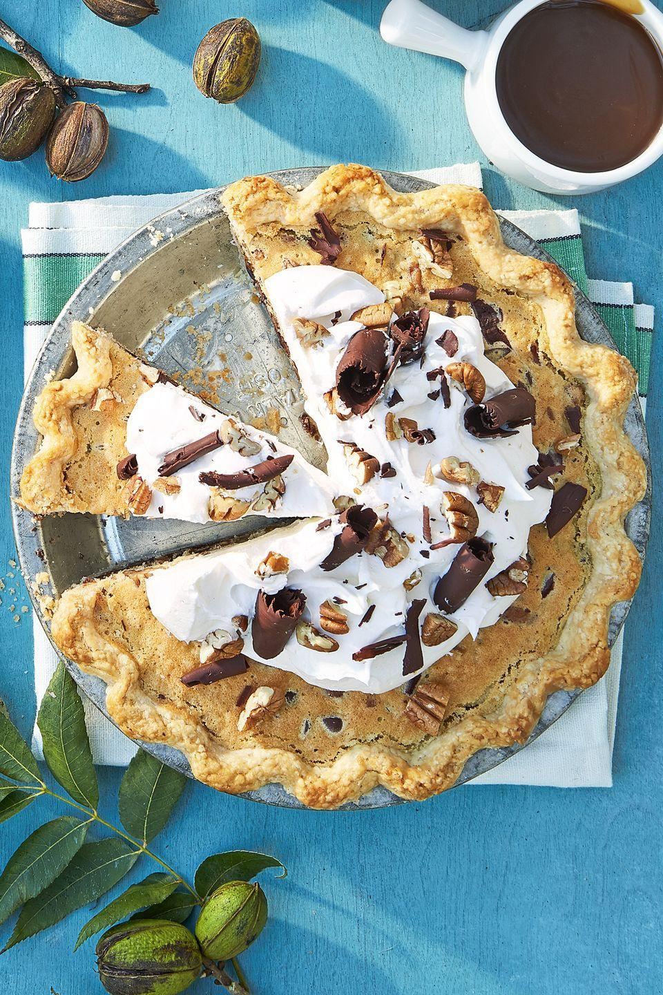 """<p>Top this boozy pecan pie with a heavy dollop of whipped cream and chocolate shavings. </p><p><strong><a href=""""https://www.countryliving.com/food-drinks/recipes/a45306/bourbon-pecan-pie-recipe/"""" rel=""""nofollow noopener"""" target=""""_blank"""" data-ylk=""""slk:Get the recipe"""" class=""""link rapid-noclick-resp"""">Get the recipe</a>.</strong> </p>"""