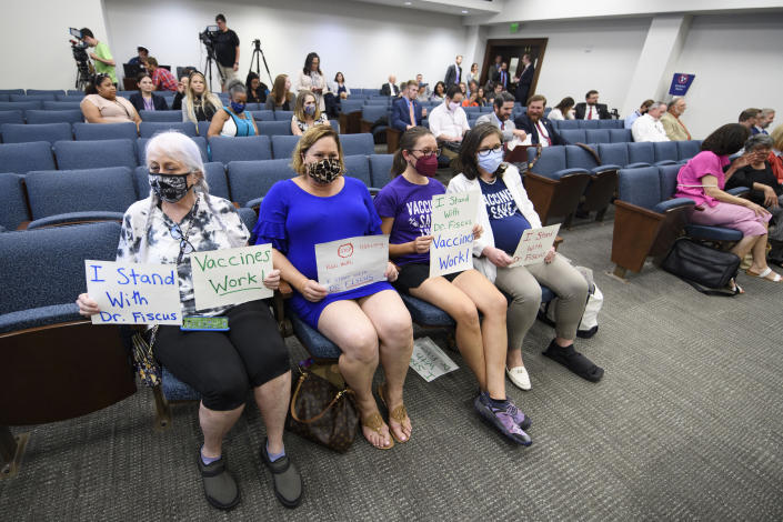 Vaccine advocates wait for the start of a state legislative committee meeting, Wednesday, July 21, 2021, in Nashville, Tenn. Being discussed was the Department of Health vaccine administration following the firing of Dr. Michelle Fiscus, the state's top vaccine official, after state lawmakers complained about efforts to promote COVID-19 vaccination among teenagers. (AP Photo/John Amis)