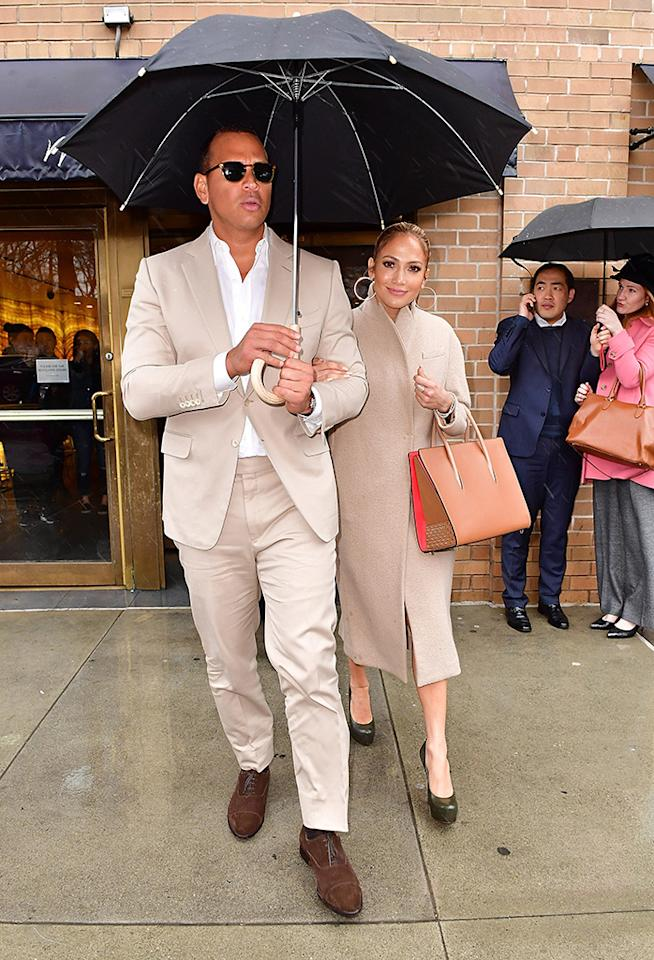 """<p>Whoa, this is getting <i>serious</i>! J.Lo and A-Rod dressed alike for a lunch with friends at trendy New York restaurant Marea the same day the retired baseballer <a rel=""""nofollow"""" href=""""https://www.yahoo.com/celebrity/alex-rodriguez-gushes-over-girlfriend-161300229.html"""">opened up about their new romance</a> — albeit awkwardly — on <i>The View</i>. (Photo by James Devaney/GC Images) </p>"""
