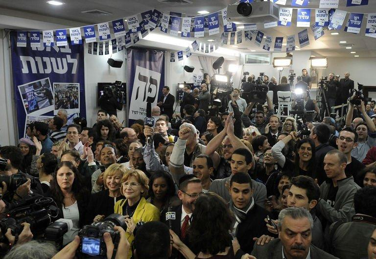 Supporters of Israeli actor, journalist and author Yair Lapid, leader of the Yesh Atid (There is a Future) party, react as the results of exit polls are announced giving the party 19 seats in the Knesset (on January 22, 2013 in Tel Aviv. Israeli Prime Minister Benjamin Netanyahu's Likud-Beitenu list was the top performer but weakened by the centrist Yesh Atid, according to TV exit polls