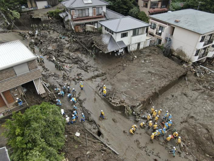 Rescuers continue a search operation at the site of a mudslide at Izusan in Atami, Shizuoka prefecture, southwest of Tokyo Tuesday, July 6, 2021.(Kyodo News via AP)