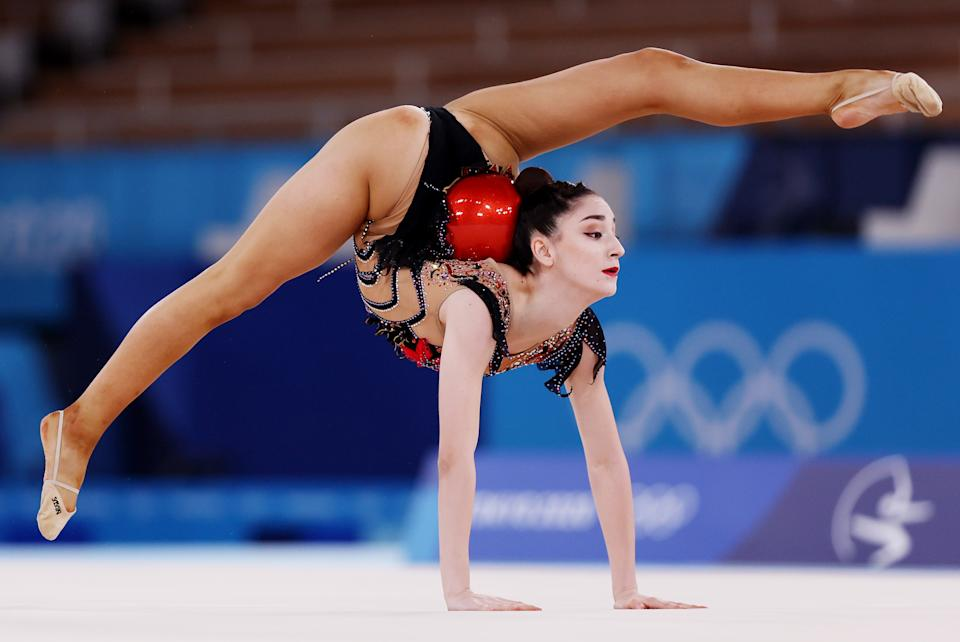 <p>Alina Adilkhanova of Team Kazakhstan competes during the Individual All-Around Qualification on day fourteen of the Tokyo 2020 Olympic Games at Ariake Gymnastics Centre on August 06, 2021 in Tokyo, Japan. (Photo by Jamie Squire/Getty Images)</p>