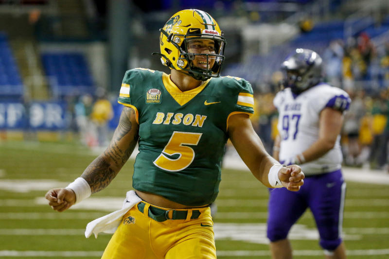 North Dakota State quarterback Trey Lance celebrates the touchdown run by Hunter Luepke against Central Arkansas in the fourth quarter of an NCAA college football game Saturday, Oct. 3, 2020, in Fargo, N.D. North Dakota State won 39-28. (AP Photo/Bruce Kluckhohn)