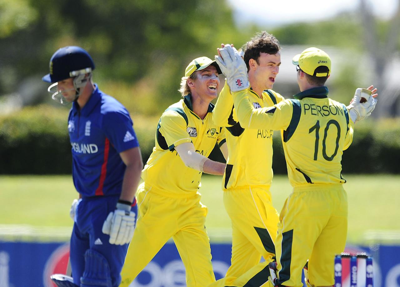 TOWNSVILLE, AUSTRALIA - AUGUST 11:  Ashton Turner (2nd right) of Australia celebrates the wicket of Ben Duckett of England during the ICC U19 Cricket World Cup 2012 match between Australia and England at Tony Ireland Stadium on August 11, 2012 in Townsville, Australia.  (Photo by Ian Hitchcock-ICC/Getty Images)