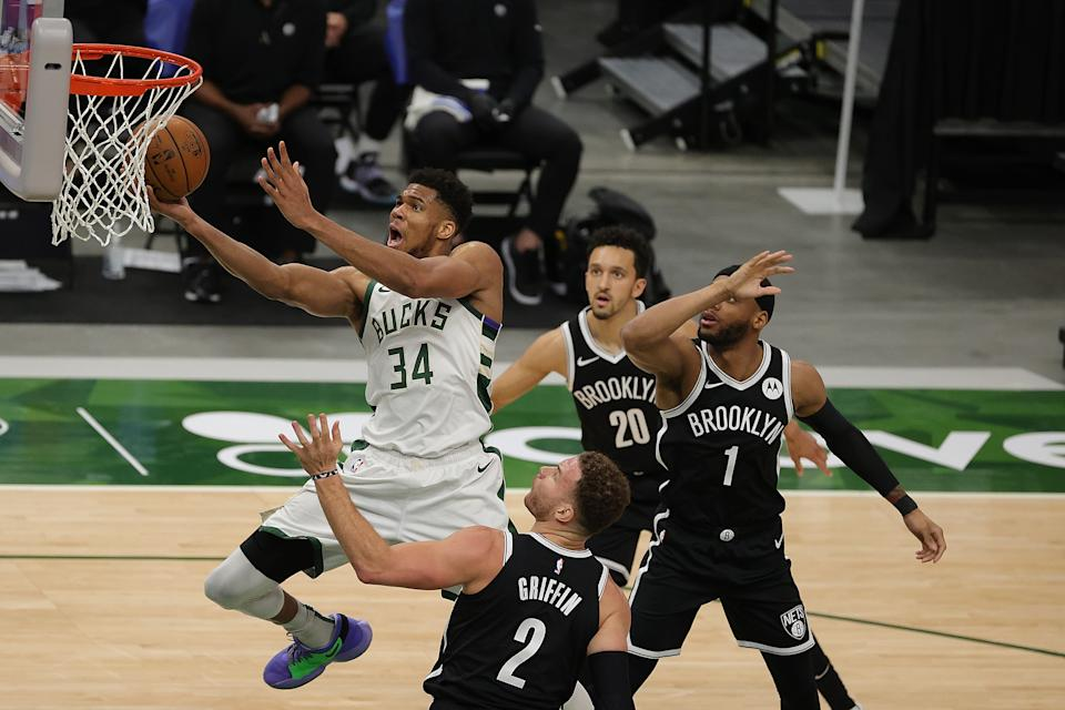 Giannis Antetokounmpo #34 of the Milwaukee Bucks drives to the basket against Blake Griffin #2 of the Brooklyn Nets during the second half of a game at Fiserv Forum on May 04, 2021 in Milwaukee, Wisconsin. NOTE TO USER: User expressly acknowledges and agrees that, by downloading and or using this photograph, User is consenting to the terms and conditions of the Getty Images License Agreement. (Photo by Stacy Revere/Getty Images)
