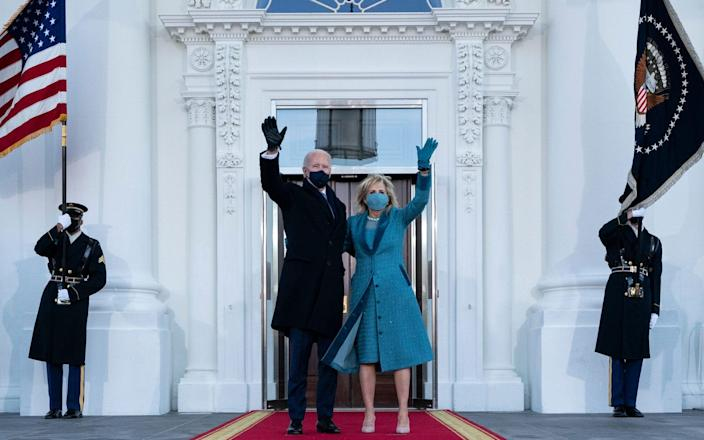 US President Joe Biden and first lady Jill Biden wave as they arrive at the North Portico of the White House - Alex Brandon/POOL/EPA-EFE/Shutterstock /Shutterstock