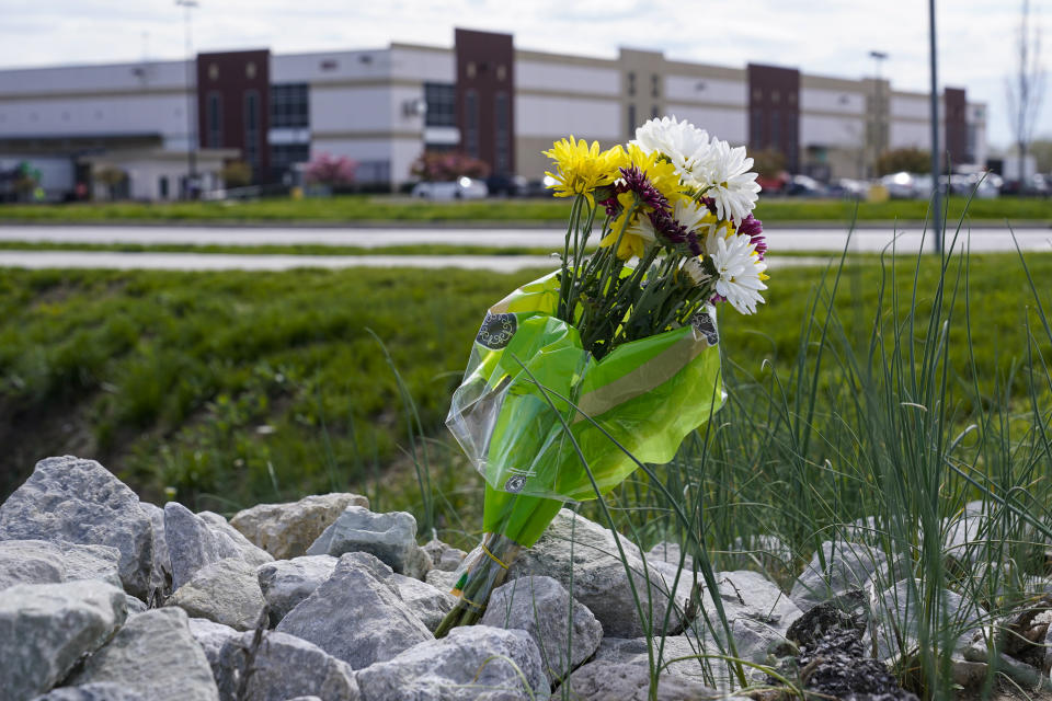 A single bouquet of flower sits in the rocks across the street from the FedEx facility in Indianapolis, Saturday, April 17, 2021 where eight people were shot and killed. A gunman killed eight people and wounded several others before apparently taking his own life in a late-night attack at a FedEx facility near the Indianapolis airport, police said, in the latest in a spate of mass shootings in the United States after a relative lull during the pandemic. (AP Photo/Michael Conroy)