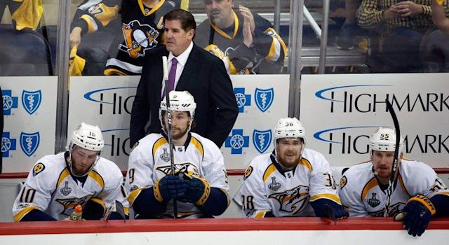 """<a class=""""link rapid-noclick-resp"""" href=""""/nhl/teams/pit/"""" data-ylk=""""slk:Pittsburgh Penguins"""">Pittsburgh Penguins</a> fans react behind <a class=""""link rapid-noclick-resp"""" href=""""/nhl/teams/nas/"""" data-ylk=""""slk:Nashville Predators"""">Nashville Predators</a> head coach Peter Laviolette and the Predators' bench after a goal was disallowed during the first period. (Gene J. Puskar/AP)"""