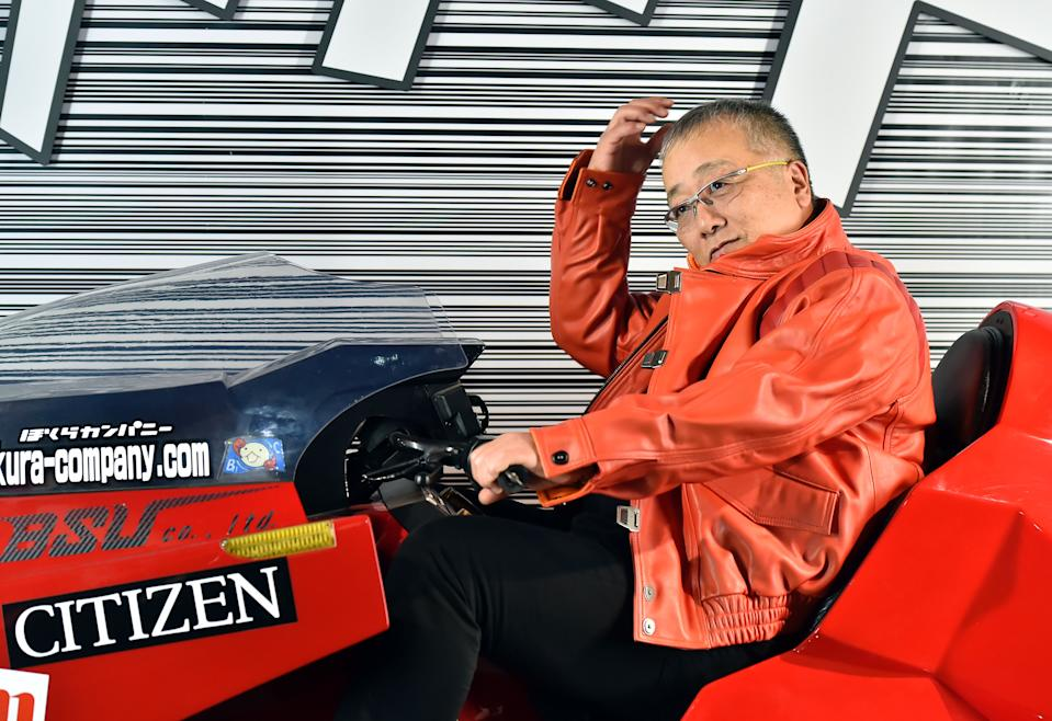 Japanese manga artist Katsuhiro Otomo poses on a replica of his Akira anime's motorbike on the eve of the 43rd Angouleme International Comics Festival on January 27, 2016. (Credit: GEORGES GOBET/AFP/Getty Images)