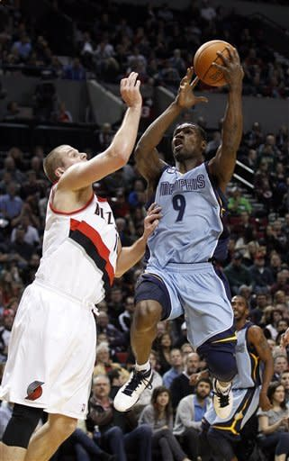 Memphis Grizzlies' Tony Allen (9) drives to the basket against Portland Trail Blazers' Joel Przybilla (10) during the first quarter of an NBA basketball game Thursday, March 22, 2012, in Portland, Ore. (AP Photo/Rick Bowmer)