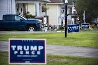 Lawn signs backing President Donald Trump and Vice President Mike Pence for re-election in Olyphant, Pennsylvania
