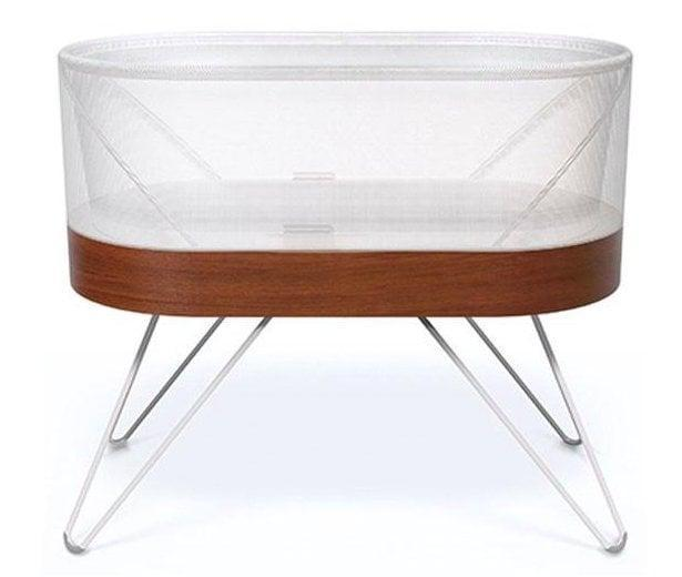 """<p>The <span>Snoo Smart Sleeper</span> ($1,495), created by Dr. Harvey Karp of The Happiest Baby on the Block fame, continues to lead the pack. It's <a href=""""https://www.popsugar.com/family/Dr-Harvey-Karp-Snoo-Bassinet-42566049"""" class=""""link rapid-noclick-resp"""" rel=""""nofollow noopener"""" target=""""_blank"""" data-ylk=""""slk:the first bassinet that actually promises a good night's sleep"""">the first bassinet that actually promises a good night's sleep</a> - for everyone. It does this by incorporating Dr. Karp's famed five S's into product form: swaddle, side or stomach, shush, swing, and suck. </p> <p>A beautiful sleeper on its own with a modern wood and mesh design, the bassinet features a mattress that produces white noise and """"swings"""" up to a half inch each direction to help lull babies to sleep. Hidden microphones detect a waking baby and signal the sleeper to respond with increasing sound and motion, essentially providing the same response parents would when a newborn fusses in the middle of the night. When our content director <a href=""""https://www.popsugar.com/family/snoo-worth-46620374"""" class=""""link rapid-noclick-resp"""" rel=""""nofollow noopener"""" target=""""_blank"""" data-ylk=""""slk:reviewed the Snoo"""">reviewed the Snoo</a>, she couldn't believe the sleep quality difference from using a standard bassinet.</p>"""