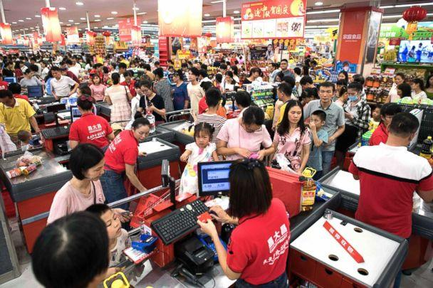 PHOTO: People buy water and food at a supermarket ahead of the arrival of the Super Typhoon Mangkhut in Zhanjiang in Guangdong province, Sept. 15, 2018. (Nicolas Asfouri/AFP via Getty Images)