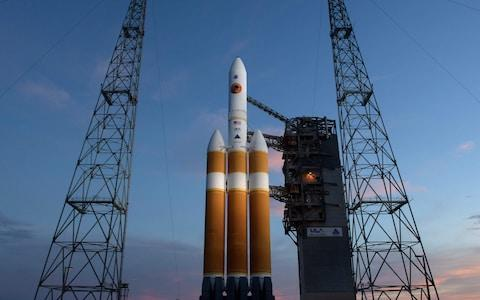 This handout photo released by NASA shows the United Launch Alliance Delta IV Heavy rocket with the Parker Solar Probe onboard shortly after the Mobile Service Tower was rolled back on August 10, 2018, Launch Complex 37 at Cape Canaveral Air Force Station in Florida