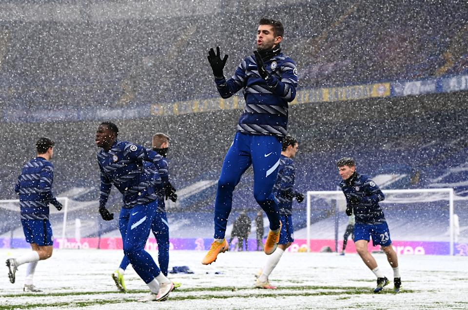 LONDON, ENGLAND - JANUARY 24: Christian Pulisic of Chelsea warms up in the snow prior to The Emirates FA Cup Fourth Round match between Chelsea and Luton Town at Stamford Bridge on January 24, 2021 in London, England. Sporting stadiums around the UK remain under strict restrictions due to the Coronavirus Pandemic as Government social distancing laws prohibit fans inside venues resulting in games being played behind closed doors. (Photo by Darren Walsh/Chelsea FC via Getty Images)