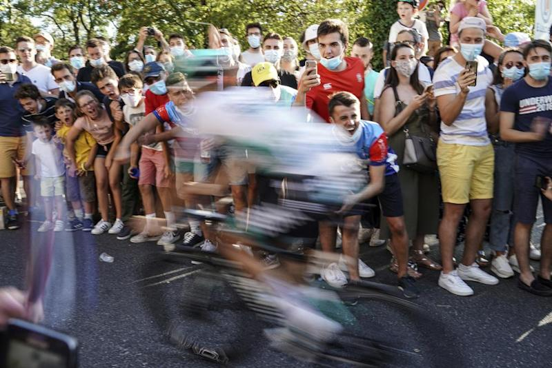 Spectators encourage cyclists during the 14th stage between Clermont-Ferrand and Lyon.