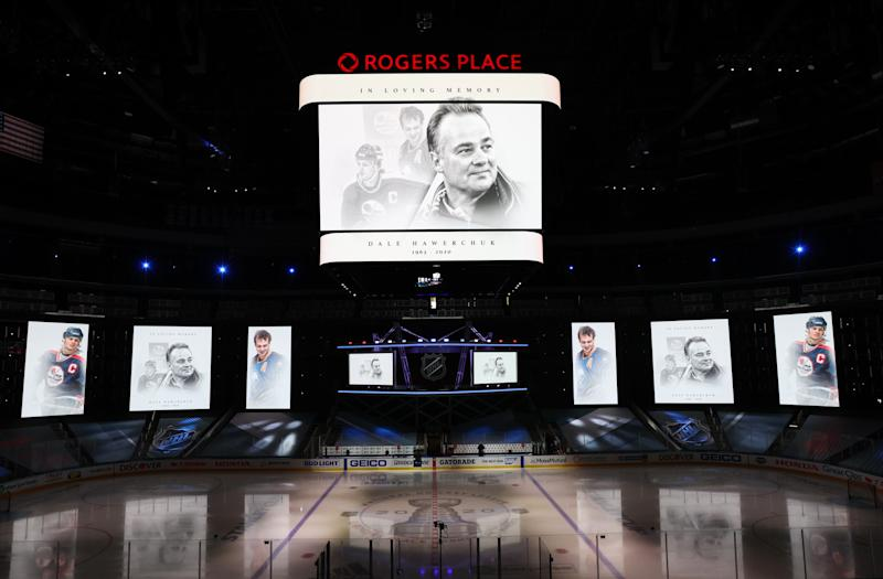 EDMONTON, ALBERTA - AUGUST 18: The center hung and arena screens honors former NHL Hall of Fame member Dale Hawerchuk prior to the the start of Game Five of the Western Conference First Round of the 2020 NHL Stanley Cup Playoff between the Dallas Stars and the Calgary Flames at Rogers Place on August 18, 2020 in Edmonton, Alberta. (Photo by Dave Sandford/NHLI via Getty Images)