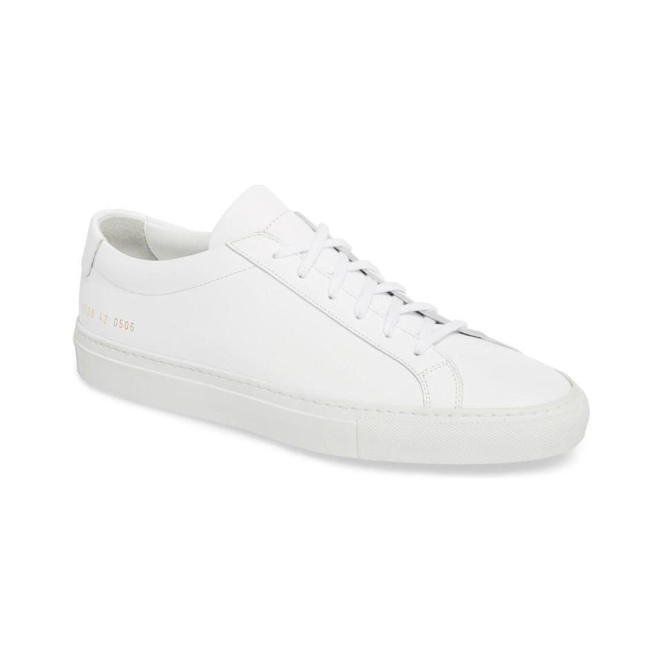 """Willing to splurge on a pair? The gold-foil factory I.D. code on the side of these Italian leather sneakers is what makes the Achilles stand out in a sea of white. $425, Nordstrom. <a href=""""https://www.nordstrom.com/s/common-projects-original-achilles-sneaker-men/4976450"""" rel=""""nofollow noopener"""" target=""""_blank"""" data-ylk=""""slk:Get it now!"""" class=""""link rapid-noclick-resp"""">Get it now!</a>"""
