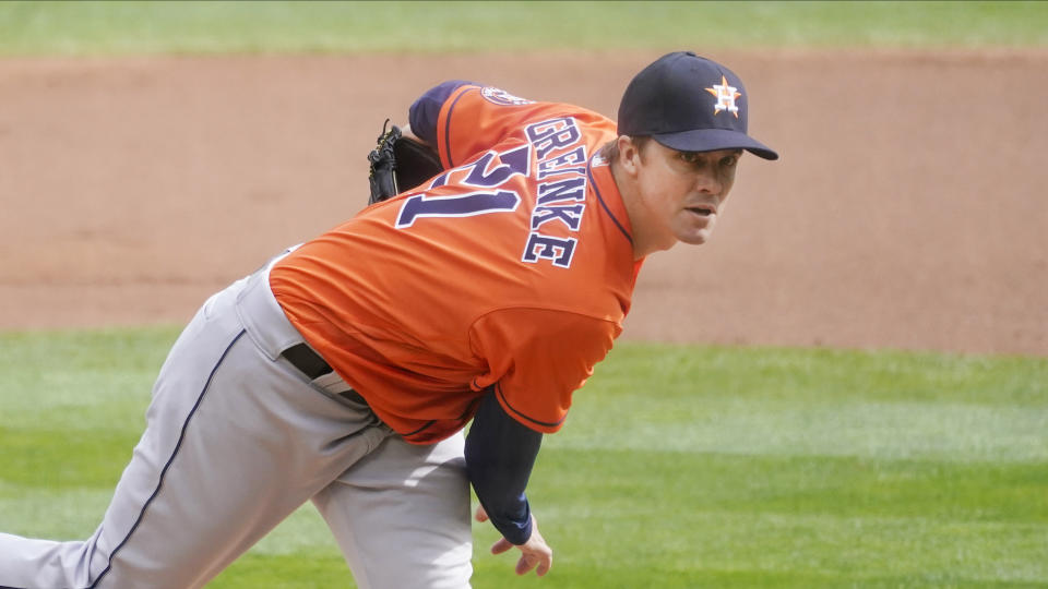 Houston Astros pitcher Zack Greinke throws against the Minnesota Twins in the first inning of an American League playoff baseball game Tuesday, Sept 29, 2020, in Minneapolis. (AP Photo/Jim Mone)