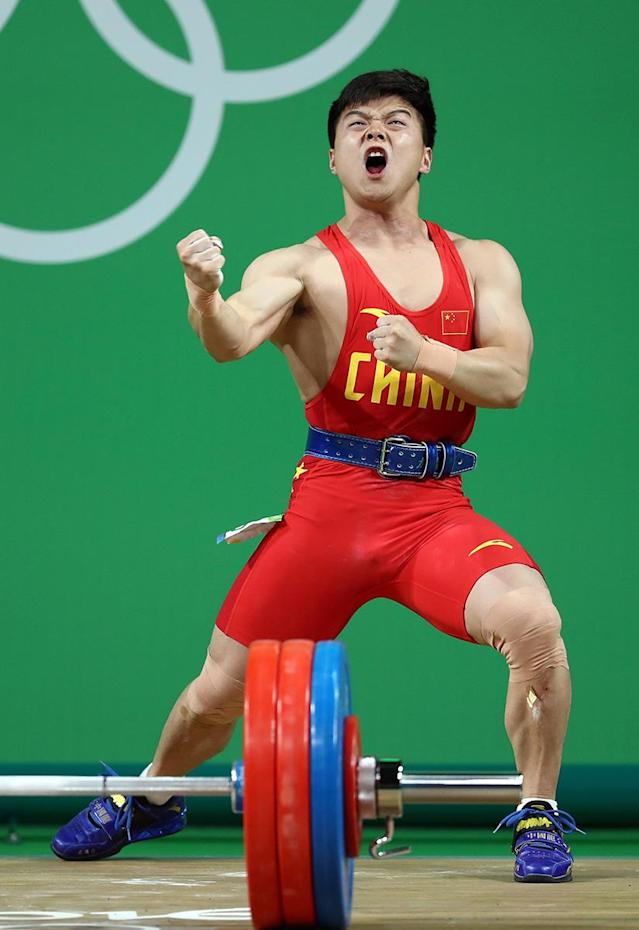 <p>Qingquan Long of China celebrates during the Men's 56kg Group A weightlifting contest on Day 2 of the Rio 2016 Olympic Games at Riocentro – Pavilion 2 on August 7, 2016 in Rio de Janeiro, Brazil. (Photo by Lars Baron/Getty Images) </p>