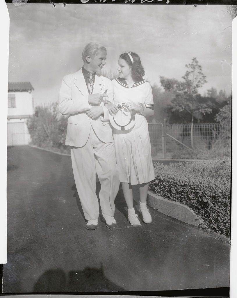 <p>Hollywood continued to promote Judy, showing her here with the '30s child star, Jackie Cooper, and hinting at a young romance. </p>