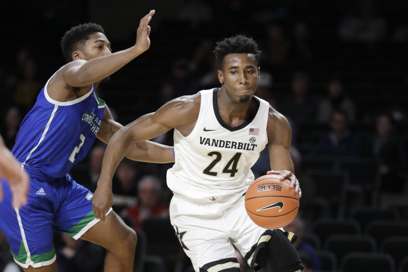 Vanderbilt forward Aaron Nesmith (24) moves past Texas A&M-Corpus Christi guard Myles Smith (2) in the first half of an NCAA college basketball game Monday, Nov. 11, 2019, in Nashville, Tenn. Nesmith led Vanderbilt with 21 points as they won 71-66. (AP Photo/Mark Humphrey)