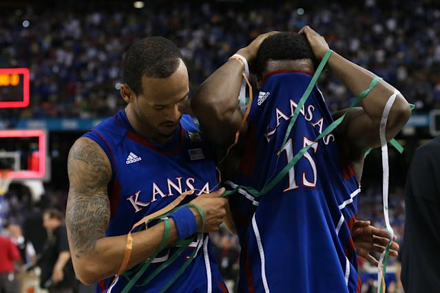 Travis Releford #24 and Elijah Johnson #15 of the Kansas Jayhawks react after losing to the Kentucky Wildcats 67-59 in the National Championship Game of the 2012 NCAA Division I Men's Basketball Tournament at the Mercedes-Benz Superdome on April 2, 2012 in New Orleans, Louisiana. (Photo by Jeff Gross/Getty Images)