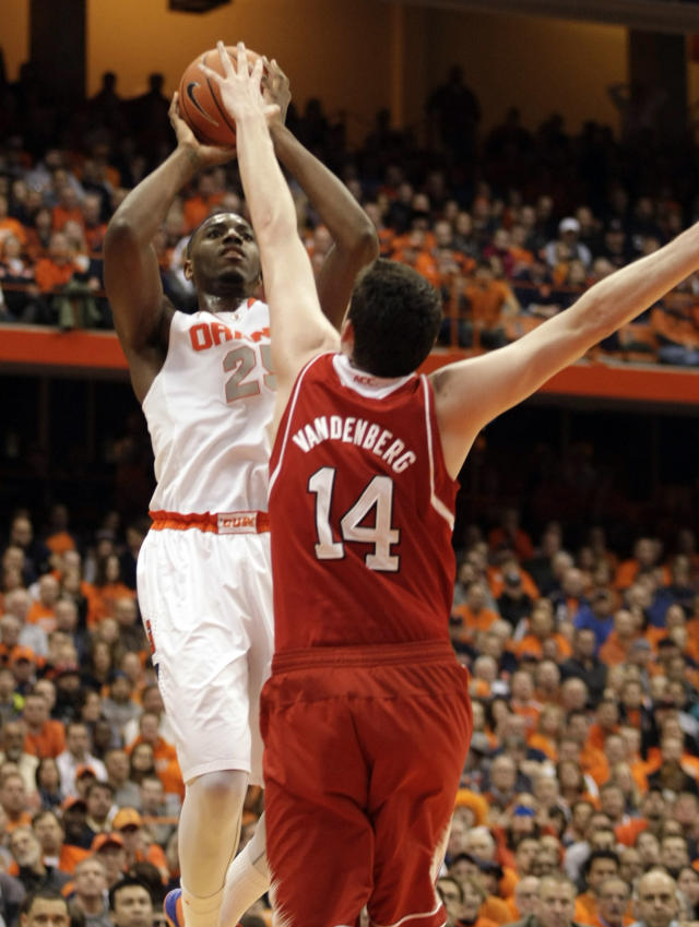 Syracuse's Rakeem Christmas, left, shoots over North Carolina State's Jordan Vandenberg, right, in the second half of an NCAA college basketball game in Syracuse, N.Y., Saturday, Feb. 15, 2014. Syracuse won 56-55. (AP Photo/Nick Lisi)