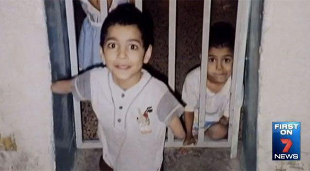 Ahmed Kelly as a young boy with his brother in the background. Source: 7News