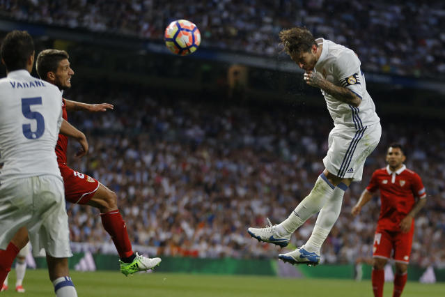 <p>Real Madrid's Sergio Ramos, top, goes for a header during the La Liga soccer match between Real Madrid and Sevilla at the Santiago Bernabeu stadium in Madrid, Sunday, May 14, 2017. (Photo: Francisco Seco/AP) </p>