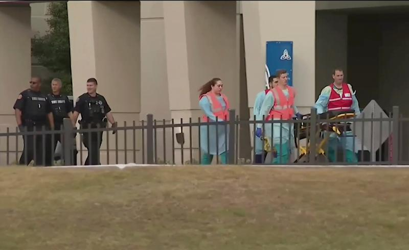 Emergency responders at the naval airbase at Pensacolo, Florida, following a shooting spree that left three people and the gunman, a Saudi trainee pilot, dead: AP