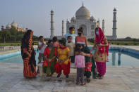 A group of Indians who visited the Taj Mahal monument that was Wednesday reopened to public after the lockdown to curb the spread of coronavirus gather to get photographed in Agra, India, Wednesday, June 16, 2021. (AP Photo)