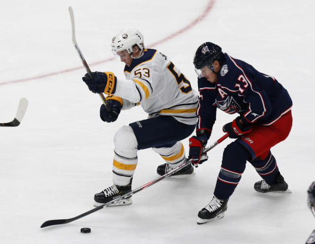 Buffalo Sabres forward Jeff Skinner, left, works against Columbus Blue Jackets forward Cam Atkinson during the third period of an NHL hockey game in Columbus, Ohio, Monday, Oct. 7, 2019. (AP Photo/Paul Vernon)