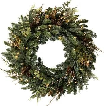 <p>Give your home some serious curb appeal with the help of this <span>Balsam Hill Mountain Meadow Artificial Wreath</span> ($179). The lush mix of greens and LED lights woven throughout will make your front door shine - literally.</p>