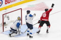 Canada's Dylan Holloway (10) reacts as the puck goes in past Finland goalie Kari Piiroinen (1) as Santeri Hatakka (2) watches during the second period of an IIHF World Junior Hockey Championship game Thursday, Dec. 31, 2020, in Edmonton, Alberta. (Jason Franson/The Canadian Press via AP)