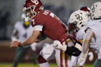 Oklahoma quarterback Spencer Rattler (7) is tackled by Baylor linebacker Dillon Doyle, right, during the second half of an NCAA college football game Saturday, Dec. 5, 2020, in Norman, Okla. (AP Photo/Sue Ogrocki)