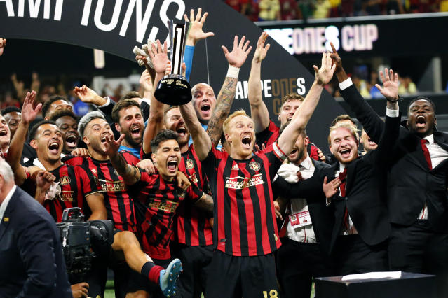 Atlanta United players celebrateswith the trophy after defeating Club America 3-2 in the Campeones Cup soccer final Wednesday, Aug. 14, 2019, in Atlanta. (AP Photo/John Bazemore)