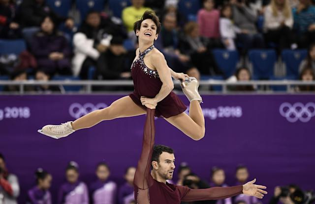 <p>Canada's Meagan Duhamel and Canada's Eric Radford compete in the figure skating team event pair skating free skating during the Pyeongchang 2018 Winter Olympic Games at the Gangneung Ice Arena in Gangneung on February 11, 2018. / AFP PHOTO / ARIS MESSINIS </p>
