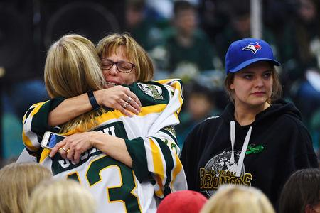 Mourners comfort each other during a vigil at the Elgar Petersen Arena, home of the Humboldt Broncos, to honour the victims of a fatal bus accident in Humboldt, Saskatchewan, Canada April 8, 2018. Jonathan Hayward/Pool via REUTERS