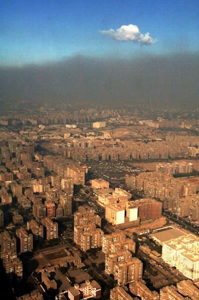 FILE - In this Sunday, Oct. 29, 2006 file photo, smog covers the city of Cairo, Egypt, where 2,000,000 cars on the streets and many unregistered lead and copper smelters heavily pollute. The Quran, Islam's holy book, is filled with more than 1,500 verses to nature and Earth. Yet the voice of Islamic leaders is missing from the global dialogue on warming. The middle eastern nation of Qatar is hosting a U.N. conference where nearly 200 countries are trying to forge a joint plan to fight global warming, which climate activists say is the greatest modern challenge to mankind. (AP Photo/Geert Vanden Wijngaert, File)