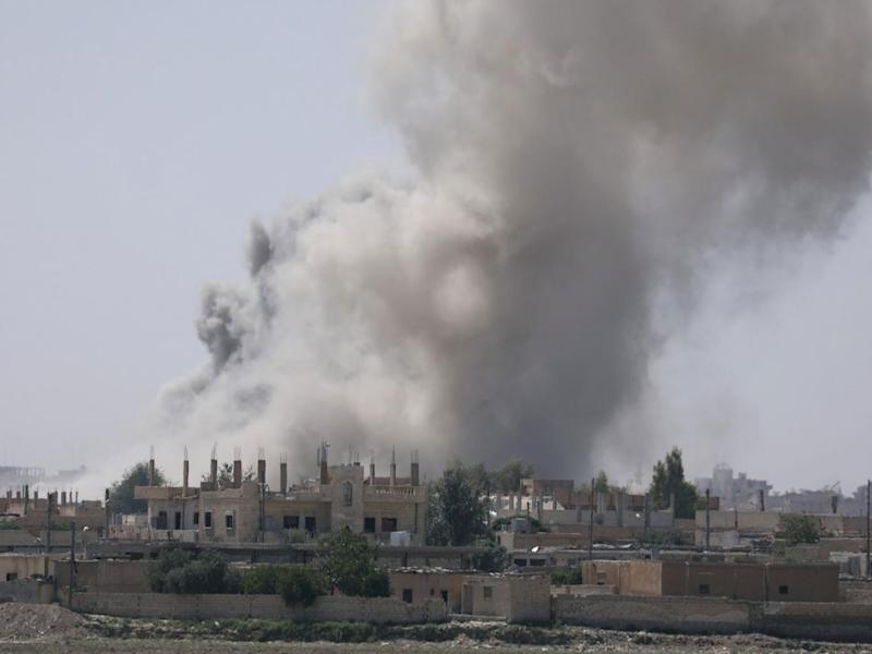 Smoke rises from the al-Mishlab district at Raqqa's southeastern outskirts on 7 June (Reuters)