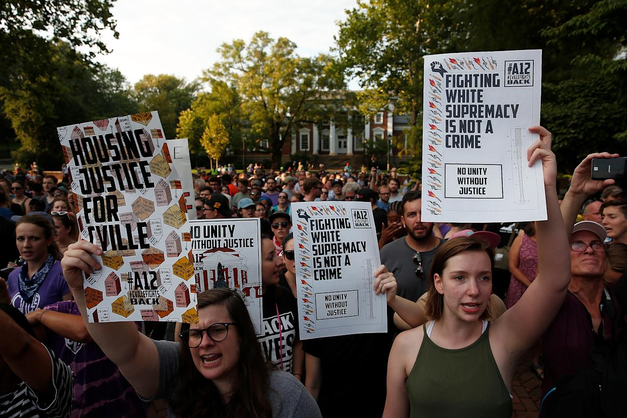 <p>Protesters gather at an event on the campus of the University of Virginia organized by the group Students Act Against White Supremacy marking the one year anniversary of a deadly clash between white supremacists and counter protesters August 11, 2018 in Charlottesville, Virginia. Charlottesville has been declared in a state of emergency by Virginia Gov. Ralph Northam as the city braces for the one year anniversary of the deadly clash between white supremacist forces and counter protesters over the potential removal of Confederate statues of Robert E. Lee and Stonewall Jackson. A 'Unite the Right' rally featuring some of the same groups is planned for tomorrow in Washington, DC. (Photo: Win McNamee/Getty Images) </p>