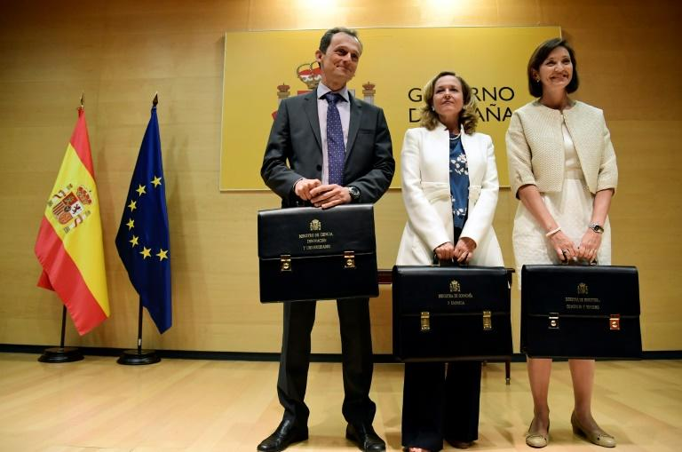 Spain's new minister of science, innovation and universities Pedro Duque (L) is a former astronaut