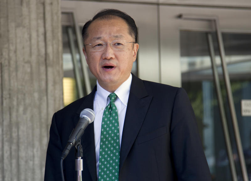 Dr. Jim Yong Kim makes a statement after arriving for his first day as president of the World Bank Group, Monday, July 2, 2012, in Washington. (AP Photo/Evan Vucci)