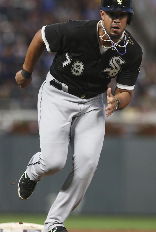 Chicago White Sox' Jose Abreu races home to score after stealing third and an error by Minnesota Twins third baseman Miguel Sano in the fourth inning of a baseball game Monday, Aug. 20, 2018, in Minneapolis. (AP Photo/Jim Mone)